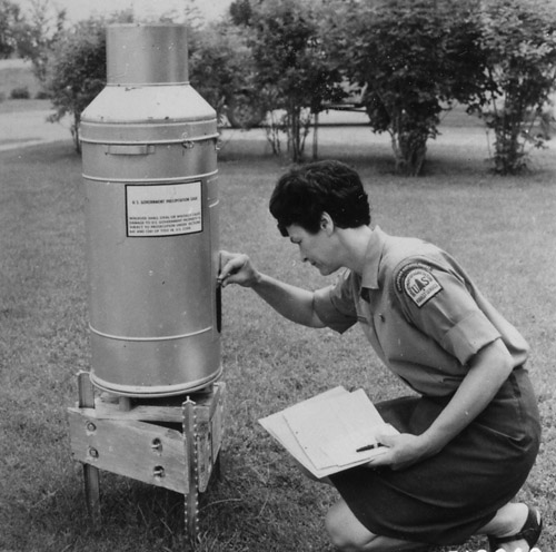 Ranger's Clerk reading precipitation gauge.