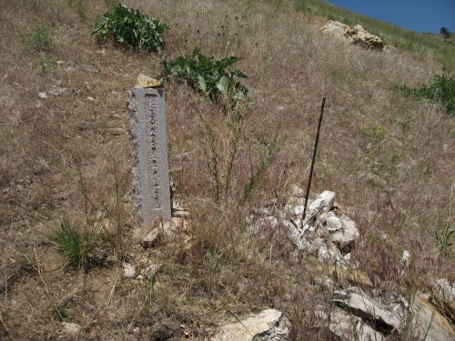 Leonard Piper's cross lies in ruins. All that remains intact is the rebar that once held the cross.