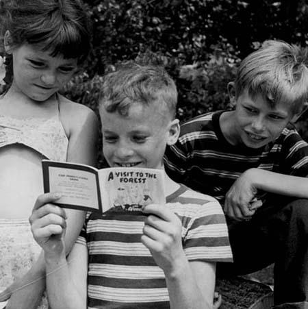 Children reading Woody comic book