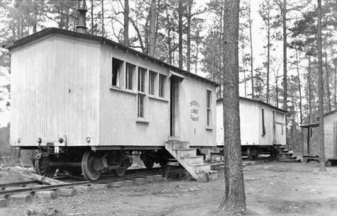 Logging camp cars.