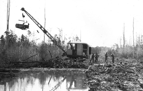Lorain Dragline purchased by Riegel Parker Corp. in March 1939 and turned over to CCC for road construction, Brunswick County, NC.