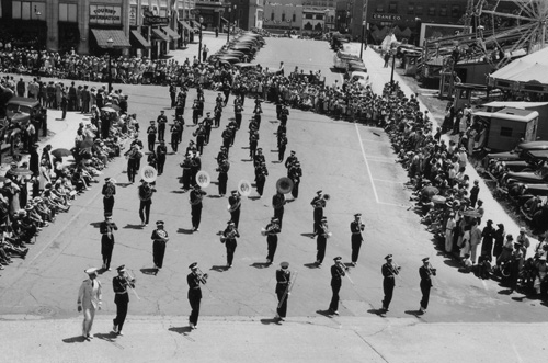 Marching band in parade through downtown Asheville, NC, 1941.