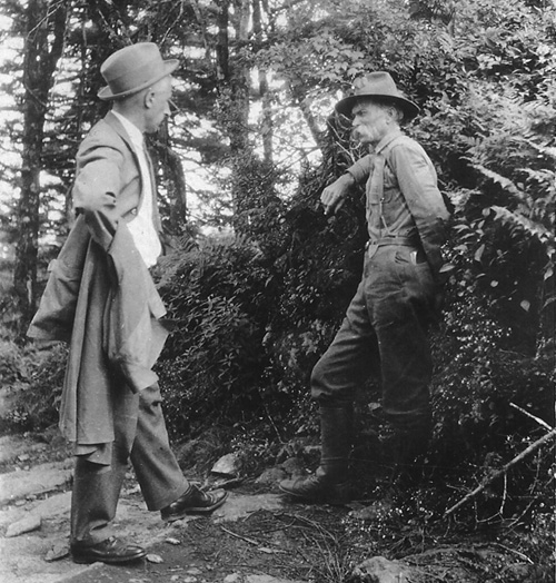North Carolina state forester John Simcox (J.S.) Holmes with warden D.L. Moser at Mt. Mitchell State Park, 1923.