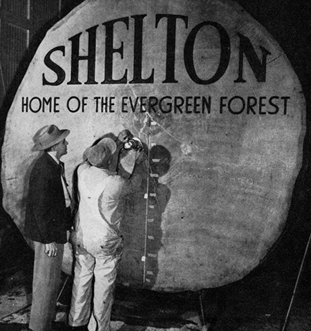 Carving Shelton Log Sign 1953