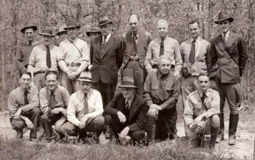 """Party on Big Levels Federal Refuge—May 1939"" is written on the back of this photo, along with the following identifications: ""Standing (Left to Right): T. E. Clarke, Leo Couch, E. Addy, Dr. Jackson, C. O. Handley, Carl Nolting, M. A. Mattoon (tall man wearing a vest), R. M. Evans, D. J. Wooley, and H. S. Mosby. Bottom Row (Left to Right): B. C. Park, G. L. Varney, A. L. Nelson, S. P. Goodloe, Dr. H. L. Shantz, and Mr. Thornton."""