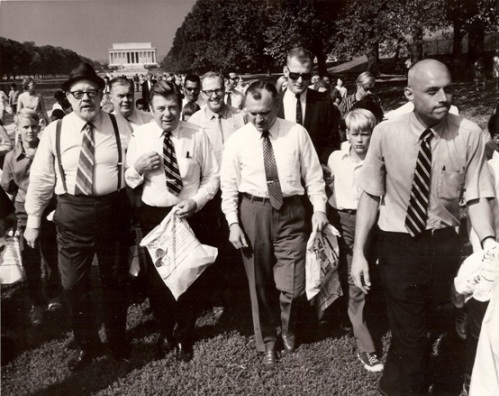 Singer Burl Ives, broadcaster Arthur Godfrey, and Secretary of the Interior Wally Hickel follow John A. Mattoon (far right) at a Johnny Horizon publicity event on the National Mall in Washington, D.C., in 1970 (Photo by Jack Rottier, National Park Service)