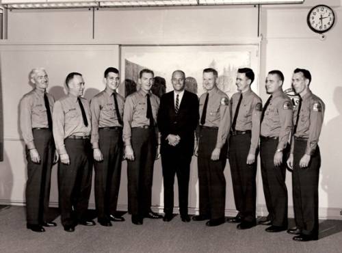 John A. Mattoon (center) with fellow employees showing off their new Forest Service shoulder emblems at the Pisgah Ranger District, Pisgah National Forest, 1963
