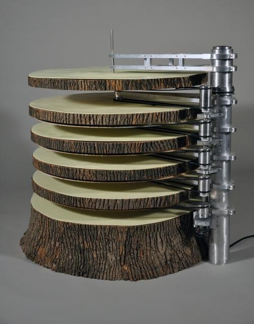 "Nathan Hansen, United States | 131 Rings, 2013 | Aluminum, bark, motor | 42 x 42 x 42"""
