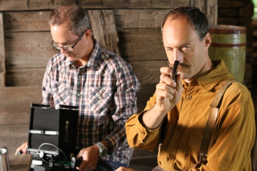 """""""Dr. Schenck"""" keeps a close eye on """"his boys"""" during a break in filming while Paul checks the playback."""