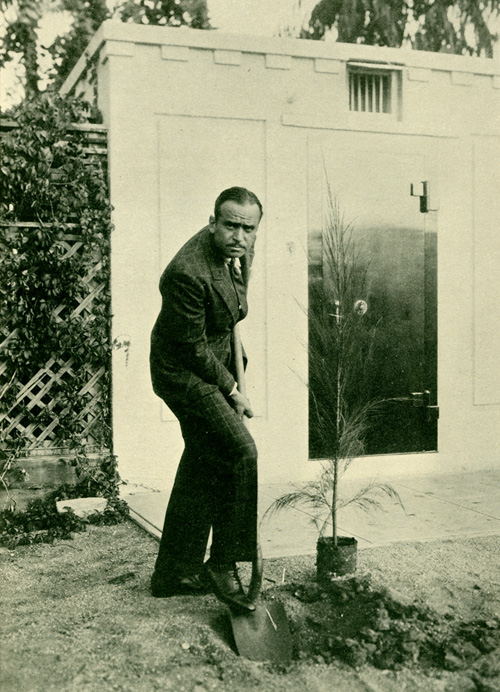 Douglas Fairbanks plants a tree.