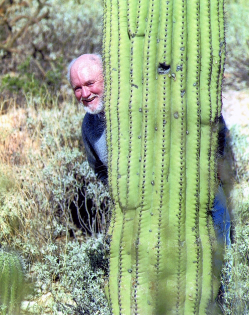 In this undated photo, Jack shows his playful side by hiding behind a sauguaro cactus.